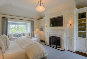 Traditional Master Bedroom with Window seat, Cement fireplace, metal fireplace, High ceiling, Built-in bookshelf, Wall sconce
