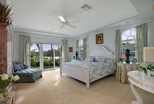 Traditional Master Bedroom with sliding glass door, Arched window, Ceiling fan, Crown molding, double-hung window