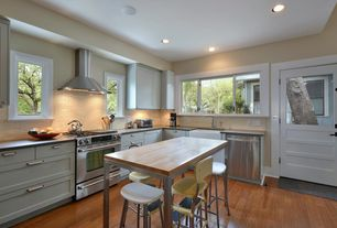 Country Kitchen with Kitchen island, can lights, gas range, Maple & stainless steel metropolitan center table, dishwasher