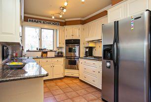 Kitchen with U-shaped, Custom hood, limestone tile floors, Marble.com Amarello Boreal Granite, Inset cabinets, Raised panel
