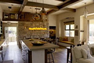 Rustic Great Room with Built-in bookshelf, Hardwood floors, specialty door, Pendant light, Exposed beam, Chandelier