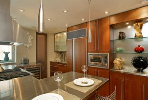 Modern Kitchen with French doors, European Cabinets, Kitchen peninsula, Built In Panel Ready Refrigerator, built-in microwave