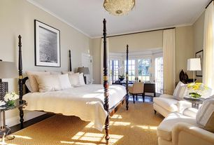 Traditional Master Bedroom with Chandelier, Laminate floors, French doors, Crown molding