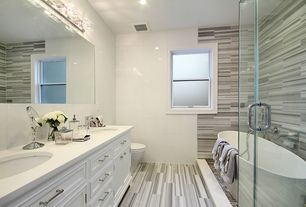 Contemporary Master Bathroom with stone tile floors, Standard height, double-hung window, Flat panel cabinets, Double sink
