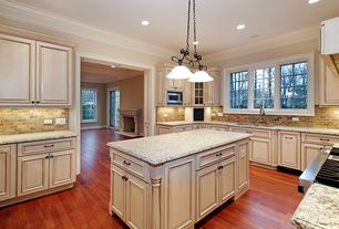 Traditional Kitchen with Flat panel cabinets, Subway Tile, Raised panel, Crown molding, Custom hood, Simple granite counters