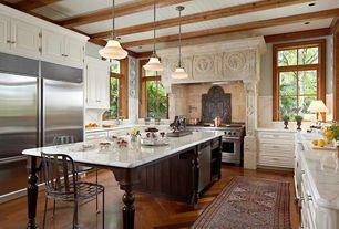 Traditional Kitchen with Exposed beam, Kitchen island, herringbone tile floors, Complex Marble, Flush, Custom hood, U-shaped