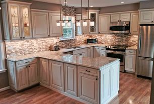 Traditional Kitchen with Simple granite counters, Raised panel, U-shaped, Standard height, can lights, dishwasher, gas range