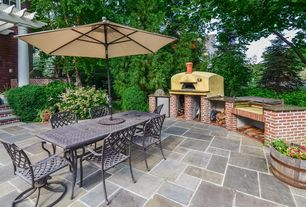 Traditional Patio with Outdoor kitchen, outdoor pizza oven, exterior stone floors