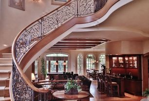Mediterranean Staircase with curved staircase, Standard height, Wall sconce, Hardwood floors