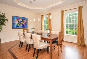 Traditional Dining Room with Chair rail, Pendant light, Crown molding, double-hung window, Hardwood floors, Standard height