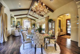 Mediterranean Great Room with High ceiling, Stylish-shag-rugs.com round flokati shag rug, Chandelier, Hardwood floors