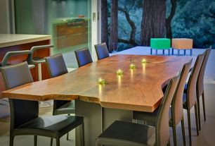Contemporary Dining Room with Standard height, sliding glass door, Concrete floors