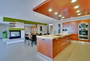 Contemporary Kitchen with Kitchen island, Concrete counters, European Cabinets, can lights, double wall oven, High ceiling