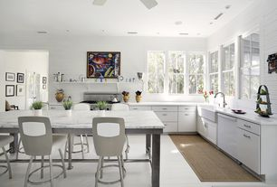 Contemporary Kitchen with Simple marble counters, Ceiling fan, dishwasher, Standard height, can lights, gas range, L-shaped
