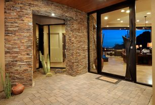 Contemporary Front Door with El dorado stone rustic ledge stone blend in cascade and sequoia