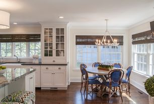 Traditional Dining Room with Crown molding, Standard height, can lights, Hardwood floors, Built-in bookshelf, Paint