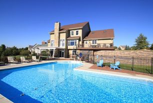 Traditional Swimming Pool with sliding glass door, Fence, exterior stone floors, double-hung window, Deck Railing, Trellis