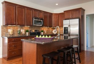 Traditional Kitchen with Undermount sink, can lights, flush light, Simple granite counters, L-shaped, full backsplash, Paint