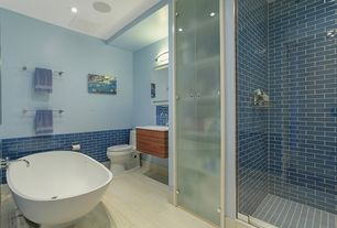 Contemporary Master Bathroom with Standard height, Hardwood floors, Shower, Freestanding, Master bathroom, can lights, Paint