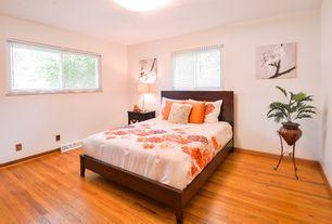 Contemporary Guest Bedroom with Mini blinds, flush light, Hardwood floors, Table lamp, Japanese cherry blossom art work