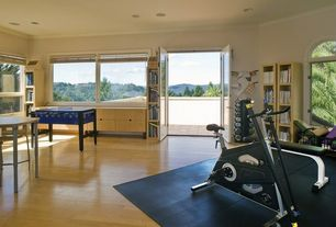 Modern Home Gym with Fat Cat Tirade Continuous-Play Foosball Table, Built-in bookshelf, French doors, Hardwood floors