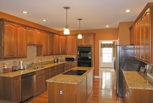 Traditional Kitchen with Laminate floors, Kitchen island, Raised panel, Pendant light, Galley, Cambria - burton brown