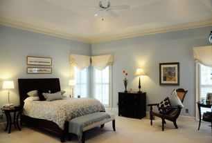 Traditional Guest Bedroom with Carpet, specialty window, can lights, Ceiling fan, Crown molding, High ceiling, Casement