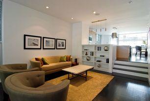 Contemporary Living Room with Built-in bookshelf, Sunken living room, Hardwood floors