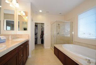 Traditional Full Bathroom with Rain shower, Built-in bookshelf, Flat panel cabinets, Concrete floors, Corian counters
