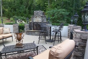 Traditional Patio with outdoor pizza oven, exterior stone floors, Gate