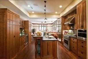 Craftsman Kitchen with Pental Original P.A. Soapstone, U-shaped, Kitchen island, Transom window, Flush, Concrete counters