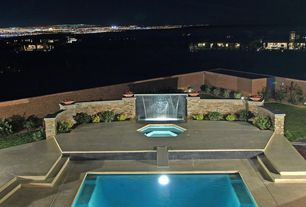Contemporary Swimming Pool with Raised beds, exterior tile floors, Pool with hot tub, Fence