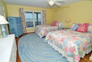 Cottage Guest Bedroom with Hardwood floors, flush light, Ceiling fan