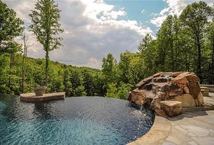 Rustic Swimming Pool with Infinity pool, exterior stone floors, Custom pool waterfall kit, Custom stamped concrete pool deck