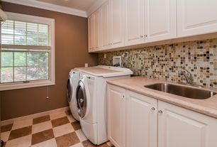 Traditional Laundry Room with Standard height, Undermount sink, stone tile floors, Paint, Crown molding, double-hung window