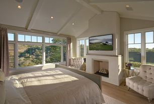 Traditional Master Bedroom with Exposed beam, picture window, Cement fireplace, Casement, can lights, Hardwood floors