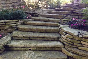 Rustic Landscape/Yard with exterior stone floors, Fence, Gravity wall, Stacked stone retaining wall, Pathway, Raised beds
