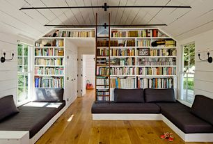 Modern Living Room with Bellacor hudson valley jasper old bronze 2-light sconce, Library Ladder, Built-in bookshelf, Loft