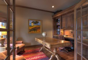 Home Office with French doors, Standard height, Built-in bookshelf, can lights, Hardwood floors