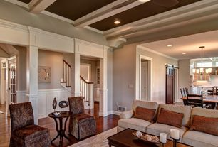 Traditional Living Room with Exposed beam, Crown molding, Hardwood floors, Ceiling fan, Columns