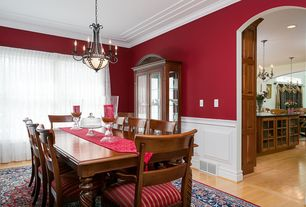 Traditional Dining Room with Standard height, Chandelier, Wainscotting, Hardwood floors, Crown molding