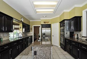 Traditional Kitchen with Raised panel, Simple granite counters, Kitchen island, Skylight, Bay window, limestone tile floors