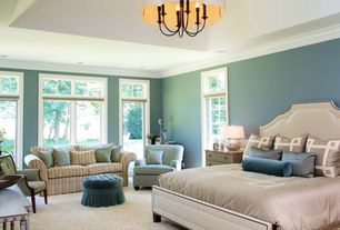 Traditional Master Bedroom with specialty window, Carpet, French doors, Built-in bookshelf, can lights, High ceiling