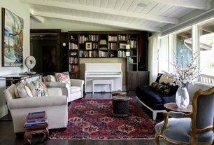 Eclectic Living Room with Elegant antique french bergere chair in pale blue poplin, Exposed beam, Built-in bookshelf