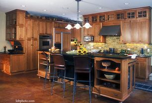 Craftsman Kitchen with Pendant light, Custom Concrete Flooring, Soapstone counters, electric cooktop, Breakfast bar, L-shaped