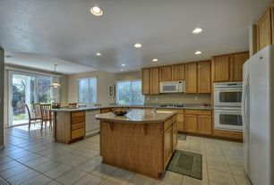 Traditional Kitchen with drop-in sink, Breakfast bar, Framed Partial Panel, Breakfast nook, can lights, partial backsplash