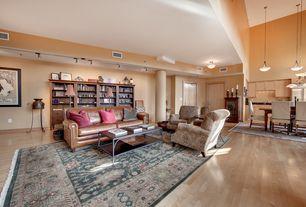 Traditional Living Room with flush light, flat door, Columns, Standard height, Hardwood floors