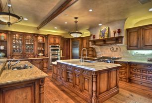 Mediterranean Kitchen with Pendant light, L-shaped, Paint, double wall oven, Stone Tile, full backsplash, specialty door