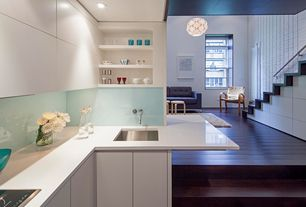 Modern Kitchen with Pendant light, Artek armchair 406, Loft, European Cabinets, Corian counters, Flush, L-shaped, Glass
