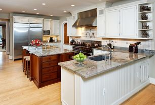 Traditional Kitchen with Paintable white beadboard, Flush, Wolfe - 6 burner + griddle, double oven, Undermount sink, U-shaped